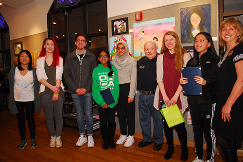 Students receive awards and congratulations for their participation in the 2018 Sister Cities Young Artists Showcase