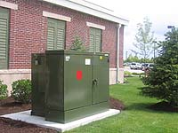 Good landscaping around a commercial transformer