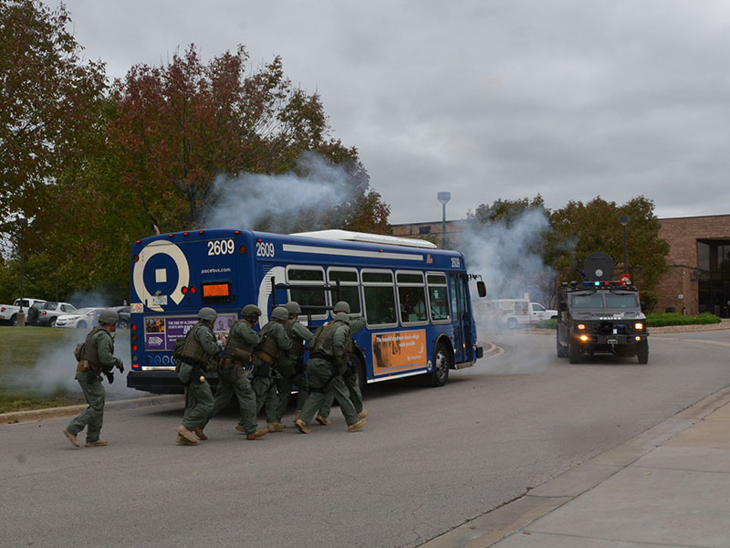 The Special Response Team moves in on its target during a demonstration