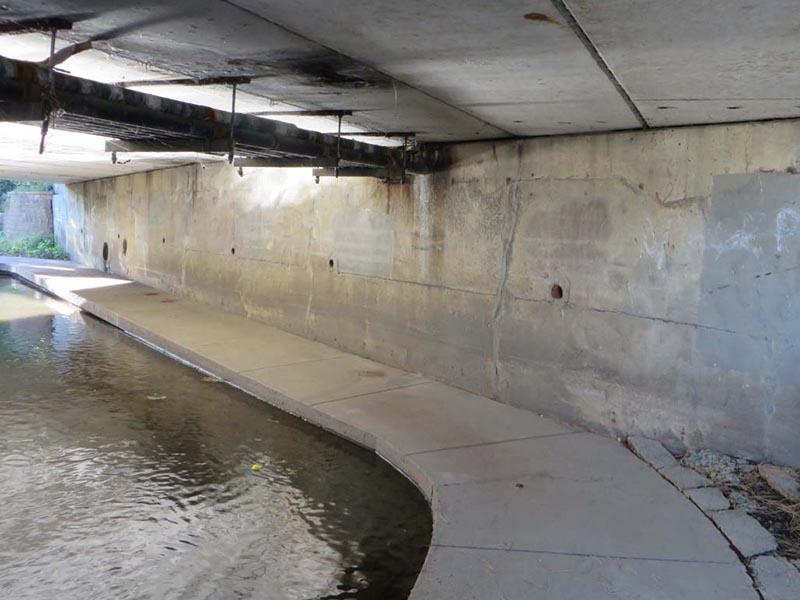A view of the Riverwalk underneath the Downtown Washington Street Bridge